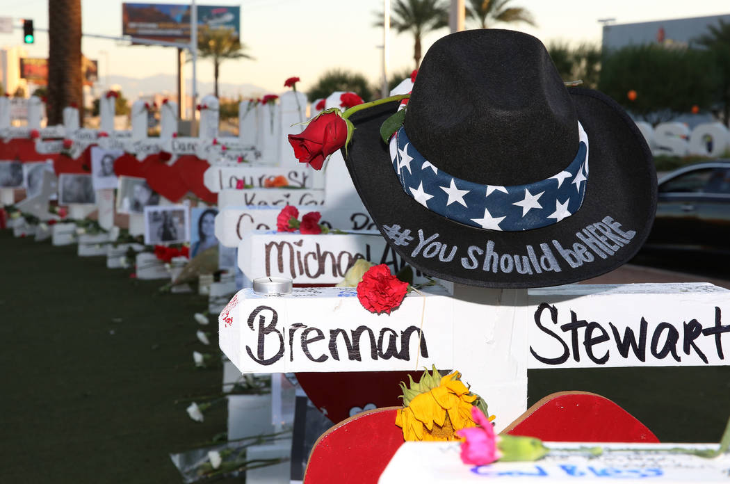 A cowboy hat is placed on a cross dedicated to Brennan Stewart on the Las Vegas Strip where 58 white crosses stand to honor the victims of Sunday's mass shooting on Friday, Oct. 6, 2017, in Las Ve ...