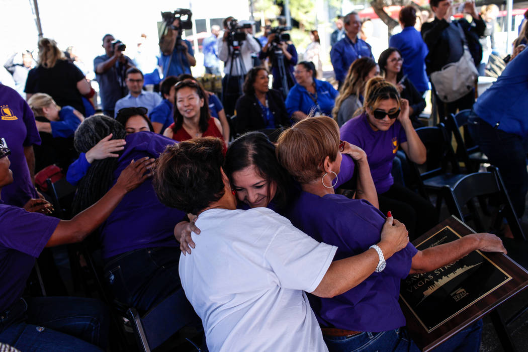 Karla Rodriguez, an EKG technician at Sunrise Hospital, 37, center, hugs Gloria Caoile, president of the Asian Pacific American Labor Alliance, 70, left, during a recognition ceremony for UMC Hosp ...
