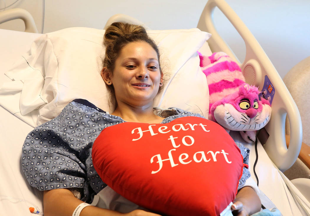 Mikenna Parry, 19, of Las Vegas smiles during an interview from her hospital bed on Friday, Oct. 6, 2017, in Las Vegas. Perry is recovering from last Sunday's gunshot in the left arm that then tra ...