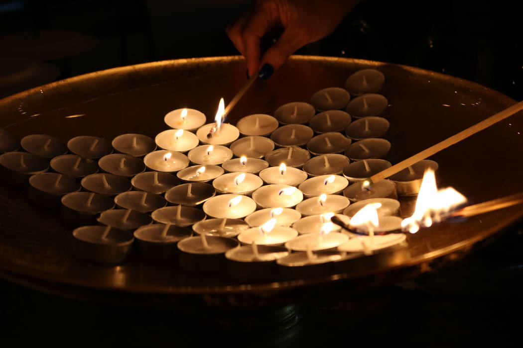 People light the candles for the victims of the Las Vegas shooting at Congregation Ner Tamid in Henderson, Friday, Oct. 6, 2017. Janna Karel Las Vegas Review-Journal