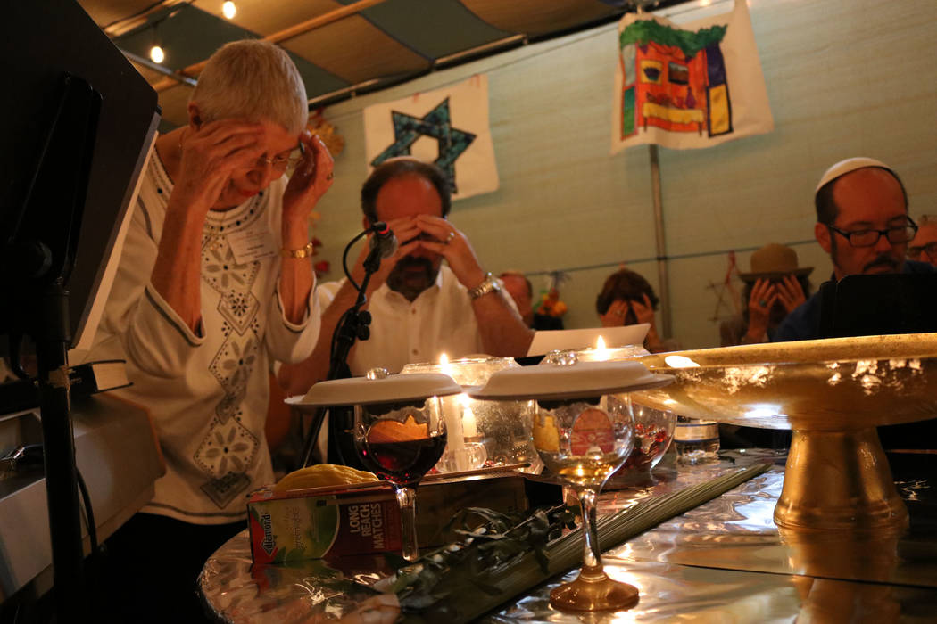 People join in Sabbath prayer under the Sukkah at Congregation Ner Tamid in Henderson, Friday, Oct. 6, 2017. Janna Karel Las Vegas Review-Journal