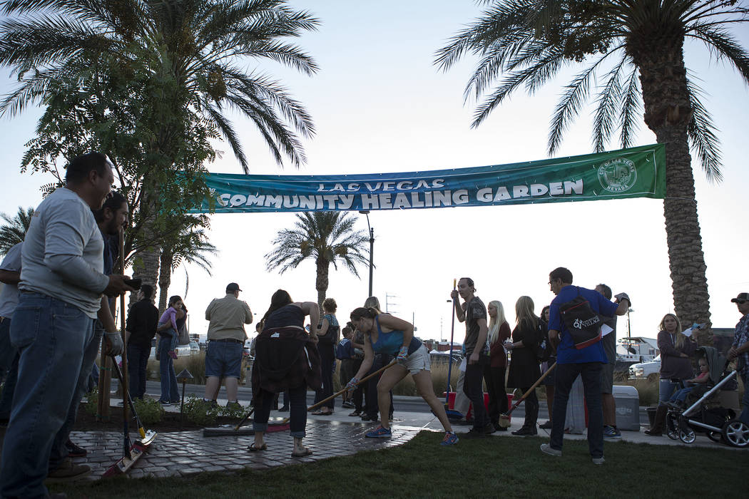 People prepare the Community Healing Garden in Las Vegas, Friday, Oct. 6, 2017. The city of Las Vegas dedicated the new healing garden to victims of Sunday's shooting. Bridget Bennett Las Vegas Re ...