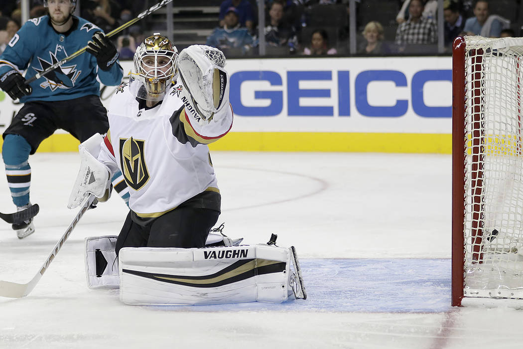 Vegas Golden Knights goalie Calvin Pickard (31) can't stop the shot allowing a goal by San Jose Sharks' Kevin Labanc during the second period of a preseason NHL hockey game, Thursday, Sept. 21, 20 ...