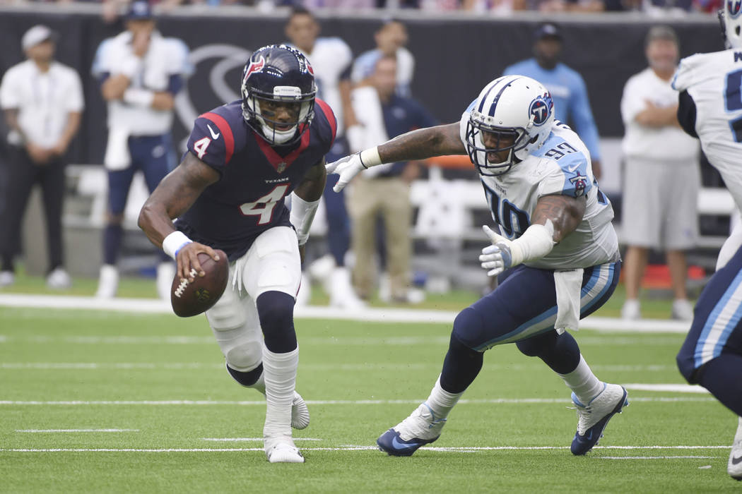 Houston Texans quarterback Deshaun Watson (4) tries to evade Tennessee Titans defensive end Jurrell Casey (99) during the first half of an NFL football game, Sunday, Oct. 1, 2017, in Houston. (AP  ...