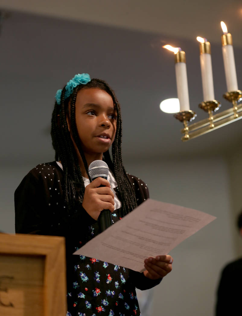 A young church attendant reads Bible passages of hope during a First African-Methodist Episcopal Church service in North Las Vegas, Sunday, Oct. 8, 2017. Elizabeth Brumley Las Vegas Review-Journal ...