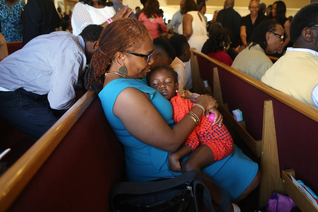 Noelle Jabal, holds Nia, 4, during a First African-Methodist Episcopal Church service in North Las Vegas, Sunday, Oct. 8, 2017. Elizabeth Brumley Las Vegas Review-Journal @EliPagePhoto
