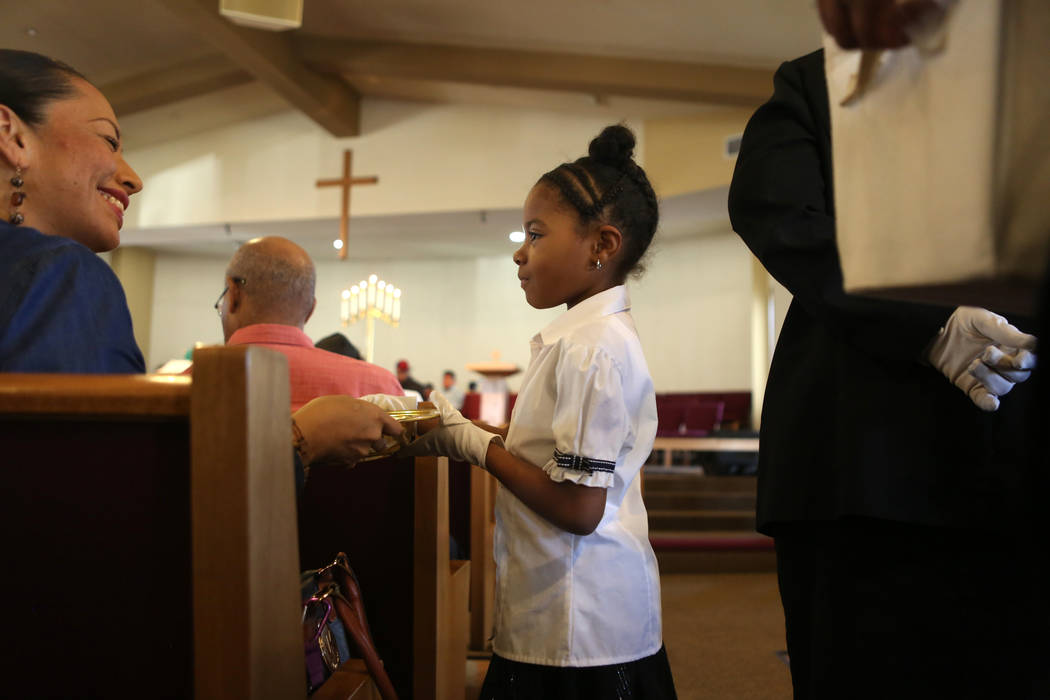 Jaylaa Thomas, 8, center, collects an offering during a First African-Methodist Episcopal Church service in North Las Vegas, Sunday, Oct. 8, 2017. Elizabeth Brumley Las Vegas Review-Journal @EliPa ...