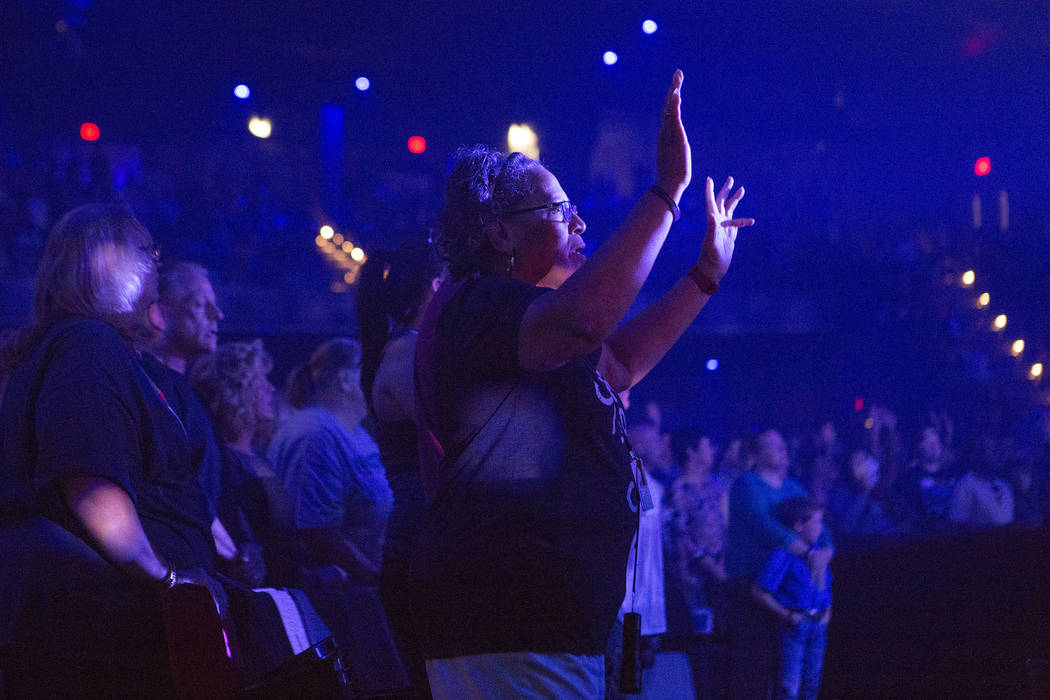 Attees join in song during a service at Central Christian Church in Henderson, Saturday, Oct. 7, 2017. The service on Saturday evening was dedicated to first responders. Bridget Bennett Las Vegas  ...