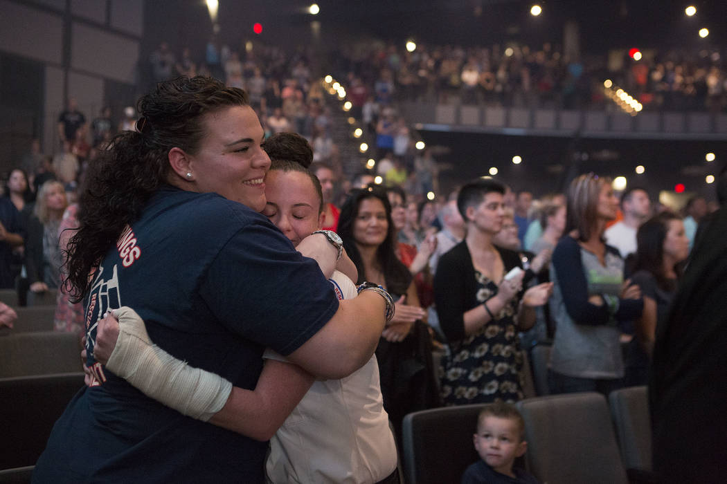 Best friends and first responders Nashley Blais, left, and Danielle Fair hug during a service at Central Christian Church in Henderson, Saturday, Oct. 7, 2017. The service on Saturday evening was  ...