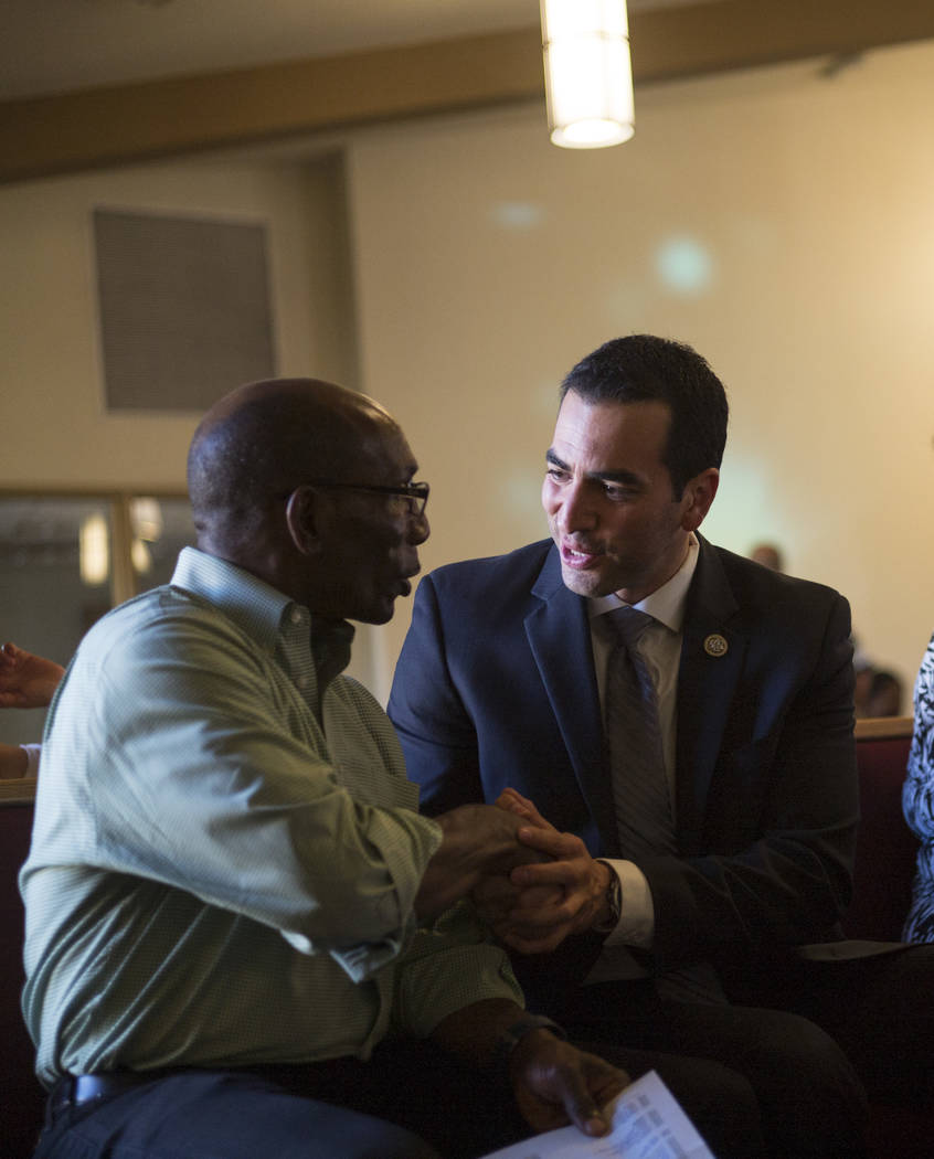 The Rev. Ralph E. Williamson, left, talks with U.S. Rep. Ruben Kihuen, D-Nev., during a healing through celebration event at First African Methodist Episcopal Church in North Las Vegas on Sunday,  ...