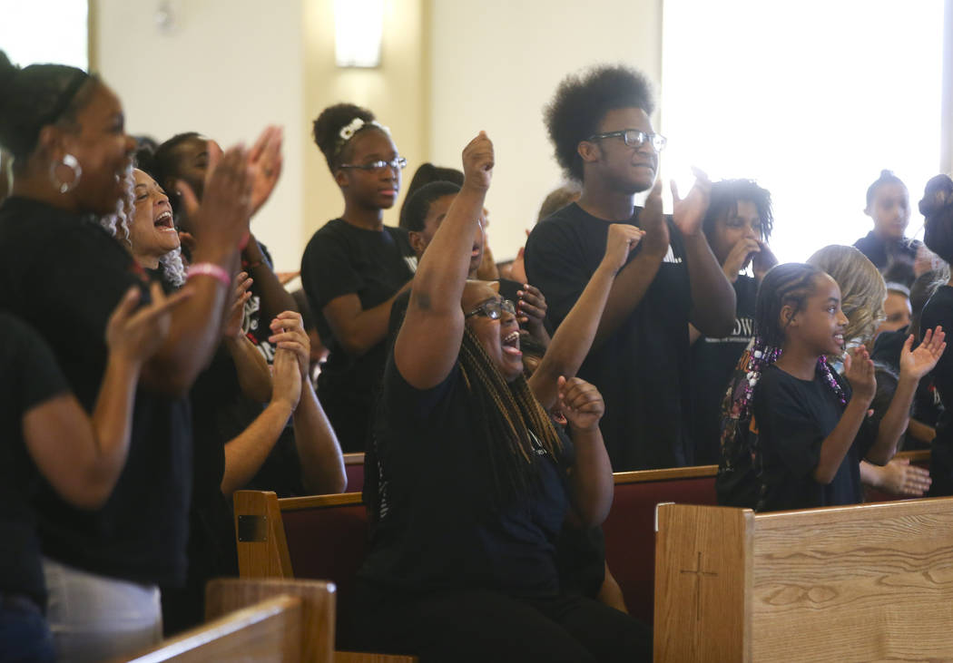 Attendees participate during a healing through celebration event at First African Methodist Episcopal Church in North Las Vegas on Sunday, Oct. 8, 2017. Chase Stevens Las Vegas Review-Journal @css ...