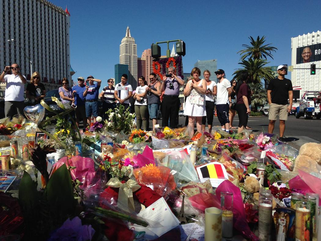 A crowd gathered Friday, Oct. 6, 2017 at a memorial on the Las Vegas Strip for the victims of Sunday night's shooting massacre. Fifty-eight people were killed and nearly 500 were injured at the Ro ...