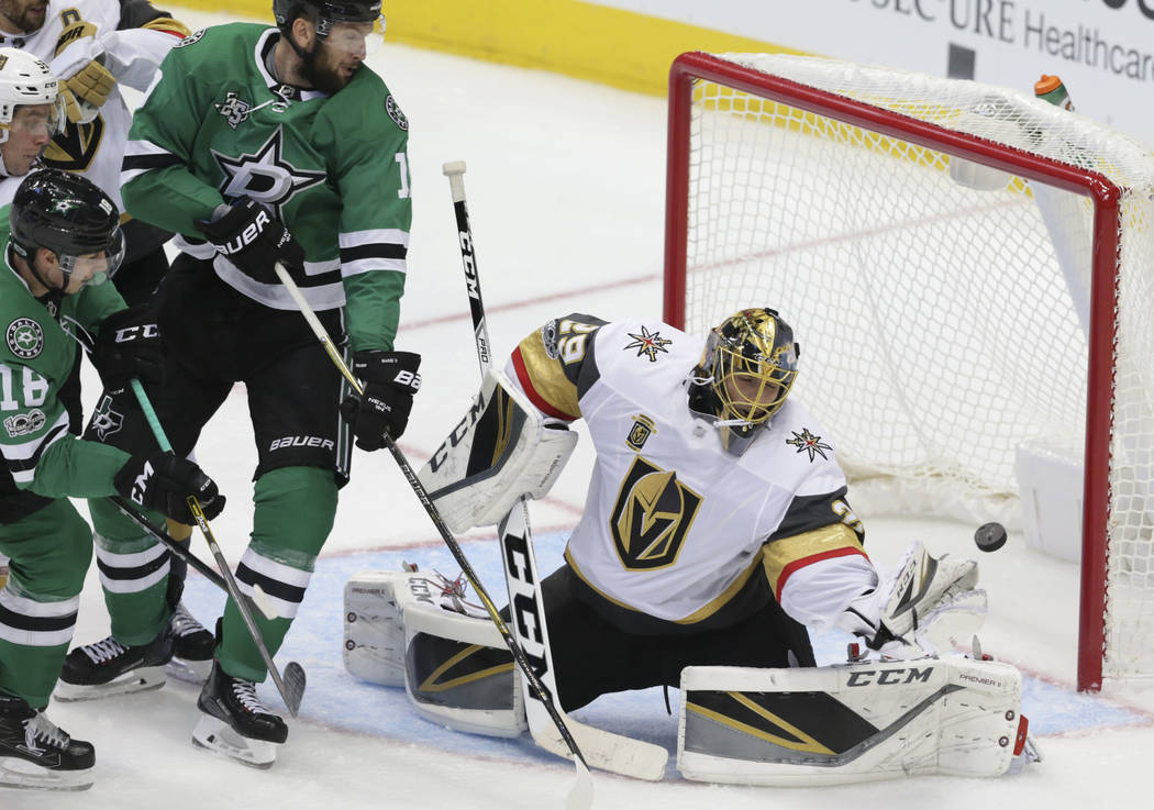 Vegas Golden Knights goalie Marc-Andre Fleury (29) blocks a shot during the second period of an NHL hockey game against the Dallas Stars in Dallas, Friday, Oct. 6, 2017. (AP Photo/LM Otero)