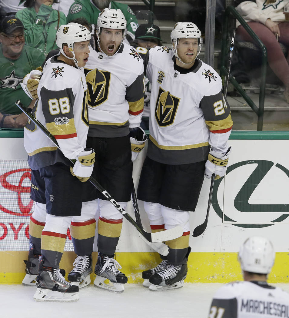 Vegas Golden Knights left wing James Neal (18) celebrates his goal with teammates Nate Schmidt (88) and Oscar Lindberg (24) during the third period of an NHL hockey game against the Dallas Stars i ...