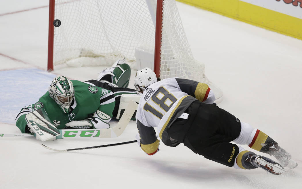 Vegas Golden Knights left wing James Neal (18) scores the winning goal against Dallas Stars goalie Kari Lehtonen (32) during the third period of an NHL hockey game in Dallas, Friday, Oct. 6, 2017. ...