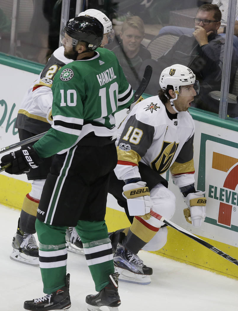 Vegas Golden Knights left wing James Neal (18) reacts to scoring his second goal as Dallas Stars center Martin Hanzal (10) skates past during the third period of an NHL hockey game in Dallas, Frid ...
