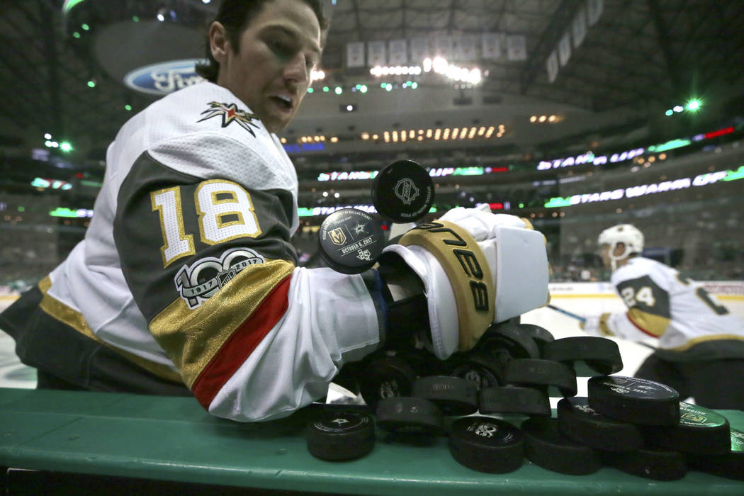 Vegas Golden Knights left wing James Neal (18) pulls pucks onto the ice for warmup before an NHL hockey game against the Dallas Stars in Dallas, Friday, Oct. 6, 2017. The Golden Knights won 2-1. ( ...
