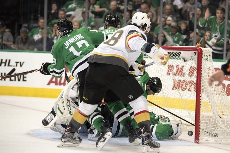 Oct 6, 2017; Dallas, TX, USA; Dallas Stars goalie Ben Bishop (30) stops a shot by Vegas Golden Knights left wing James Neal (18) during the second period at the American Airlines Center. Mandatory ...