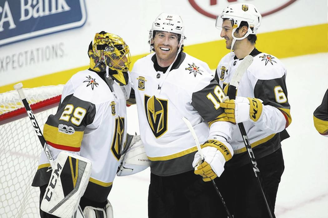 Oct 6, 2017; Dallas, TX, USA; Vegas Golden Knights goalie Marc-Andre Fleury (29) and left wing James Neal (18) and defenseman Colin Miller (6) celebrate the win over the Dallas Stars at the Americ ...