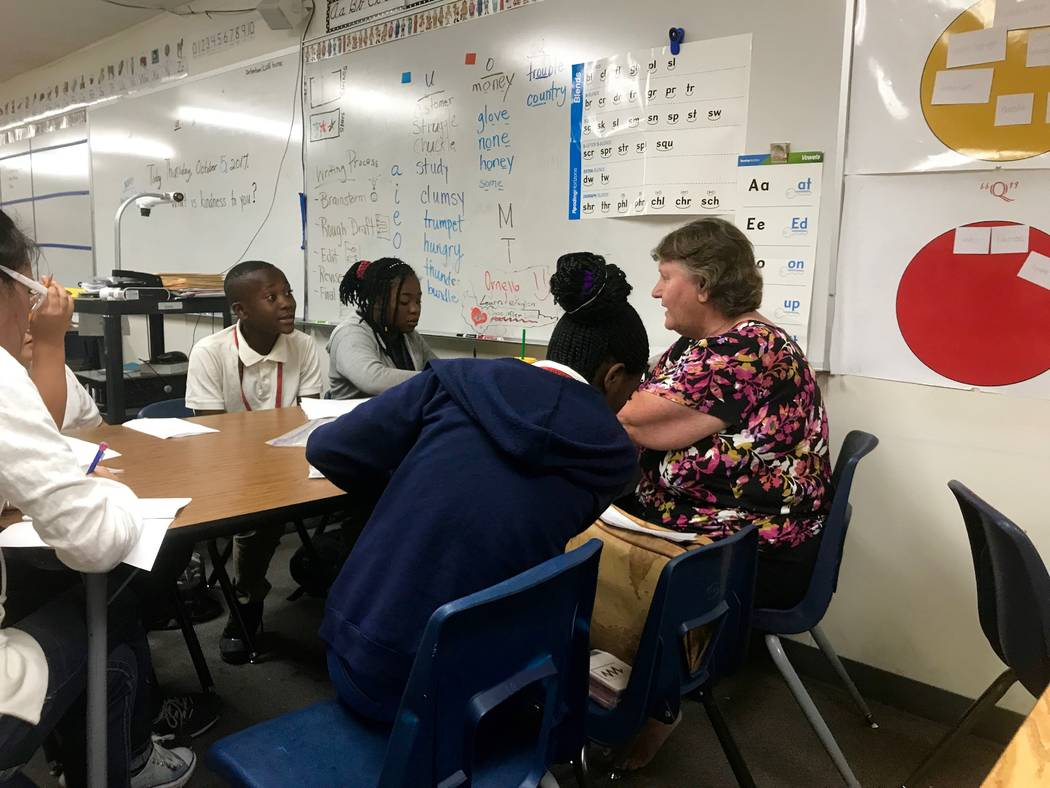 Elizabeth Bash works with a group of refugee students after school at Cashman Middle School on vocabulary and spelling. The school has a high population of refugee students because of its proximit ...