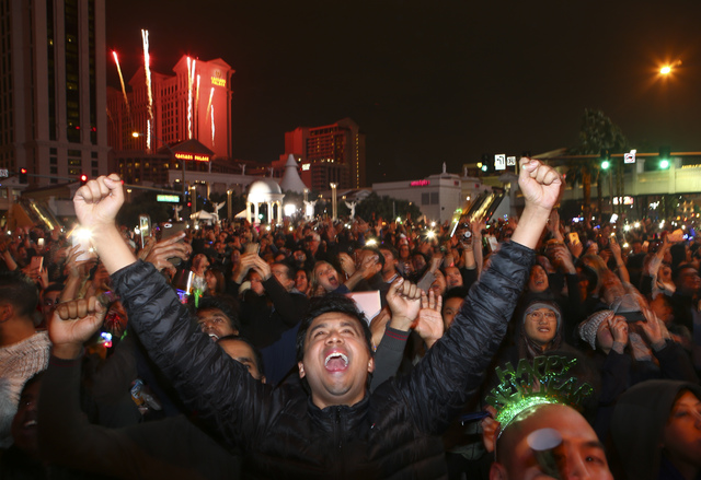 Dinesh Nallasamy celebrates as the year turns while New Year's Eve revelers gather on the Las Vegas Strip on Sunday, Jan. 1, 2017. (Chase Stevens/Las Vegas Review-Journal) @csstevensphoto