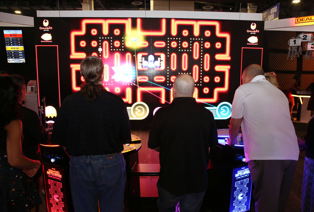 Expo goers play Pac-Man Battle at the Gamblit Gaming booth during Global Gaming Expo at the Sands Expo and Convention Center on Thursday Oct. 5, 2017, in Las Vegas. Bizuayehu Tesfaye Las Vegas Rev ...
