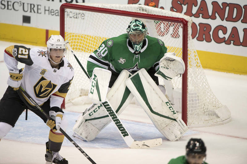 Oct 6, 2017; Dallas, TX, USA; Dallas Stars goalie Ben Bishop (30) defends against Vegas Golden Knights center Cody Eakin (21) during the first period at the American Airlines Center. Mandatory Cre ...