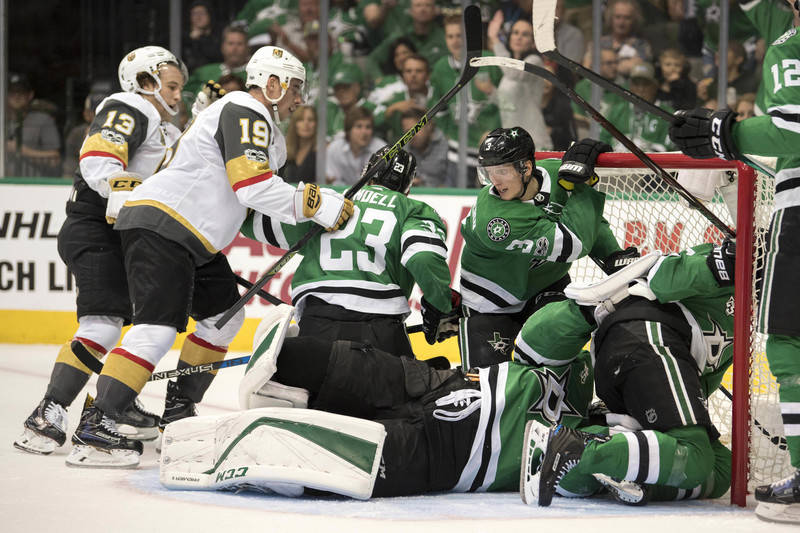 Oct 6, 2017; Dallas, TX, USA; The Dallas Stars and the Vegas Golden Knights look for the loose puck during the second period at the American Airlines Center. Mandatory Credit: Jerome Miron-USA TOD ...