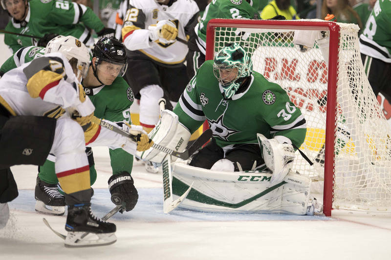 Oct 6, 2017; Dallas, TX, USA; Dallas Stars goalie Ben Bishop (30) stops a shot by Vegas Golden Knights center William Karlsson (71) during the second period at the American Airlines Center. Mandat ...
