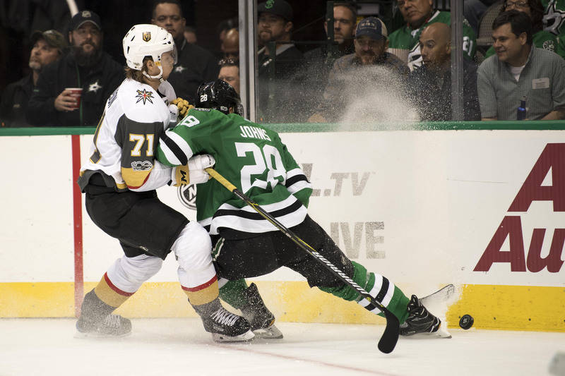 Oct 6, 2017; Dallas, TX, USA; Vegas Golden Knights center William Karlsson (71) and Dallas Stars defenseman Stephen Johns (28) fight for the puck during the second period at the American Airlines  ...