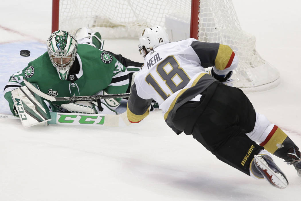 Vegas Golden Knights left wing James Neal (18) scores a goal against Dallas Stars goalie Kari Lehtonen (32) during the third period of an NHL hockey game in Dallas, Friday, Oct. 6, 2017. The Golde ...