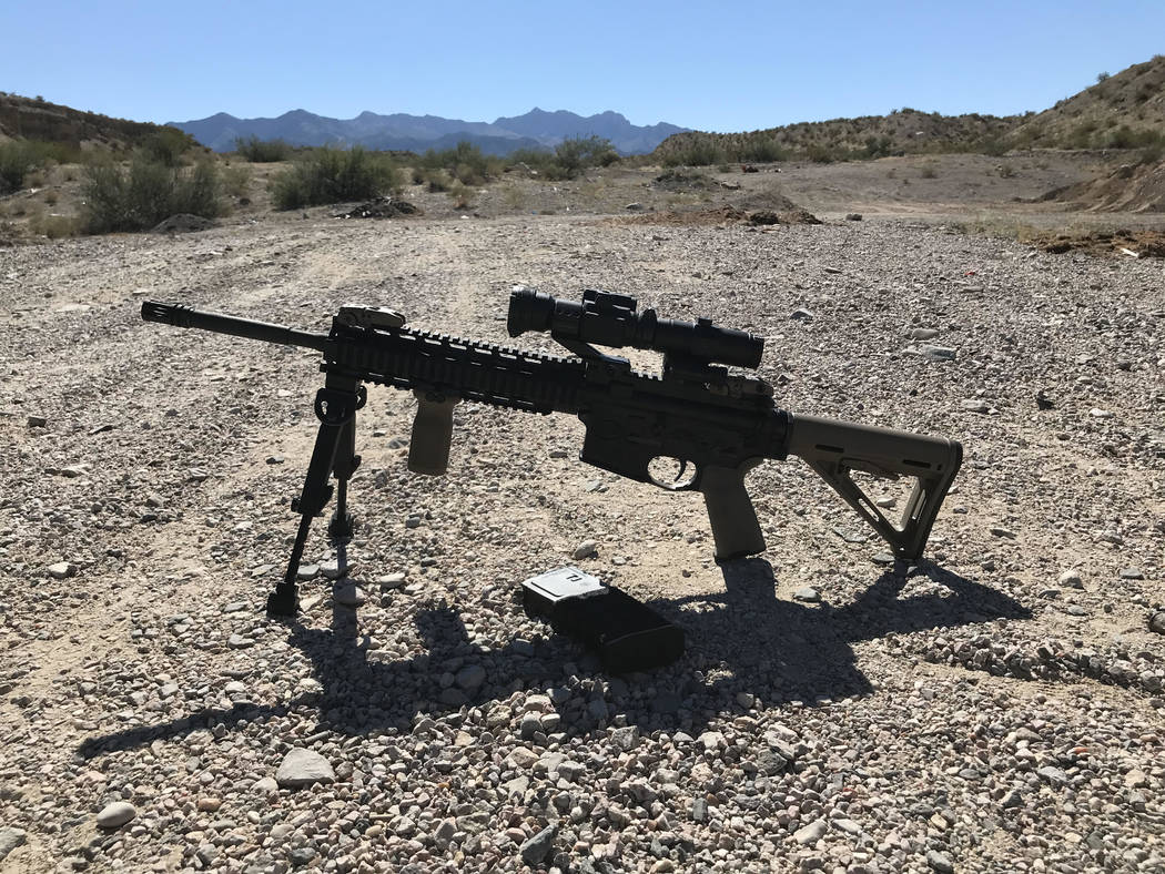 An AR-15 rifle belonging to a Mesquite resident sits on the ground in a popular spot for target shooting just outside the nearby town of Bunkerville on Friday. Henry Brean