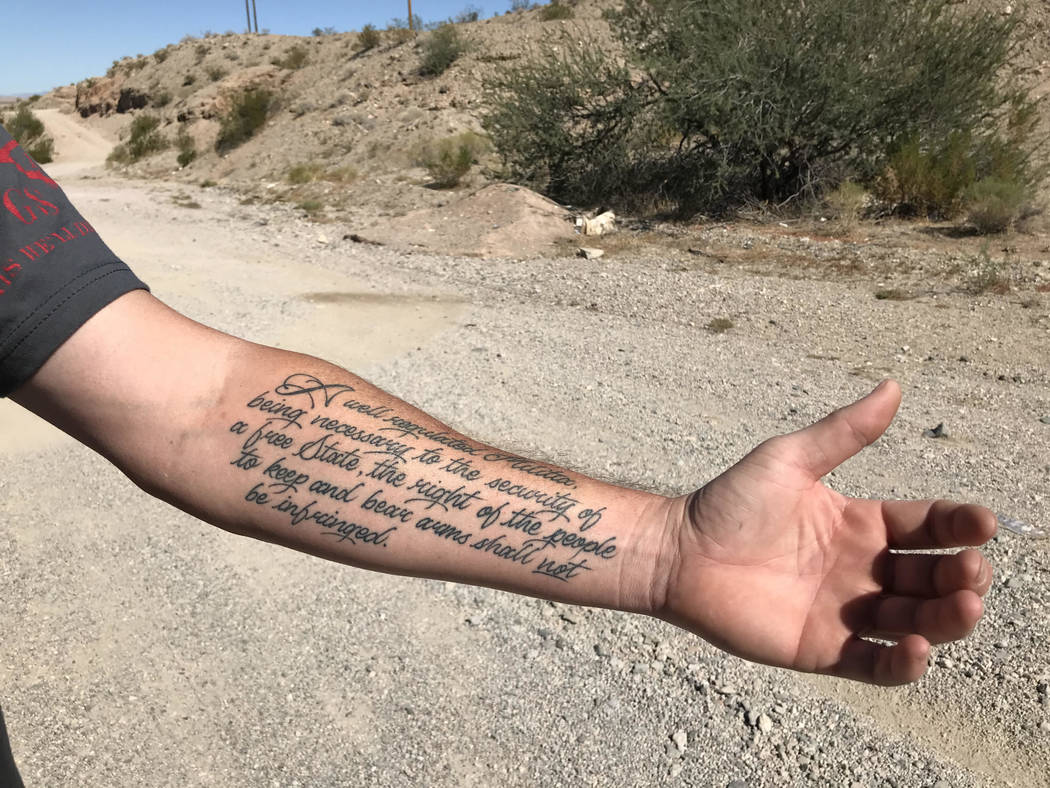 Ryan, a Mesquite resident who only gave his first name, shows off his Second Amendment tattoo during a morning of target shooting on public land just outside Bunkerville Friday. Henry Brean