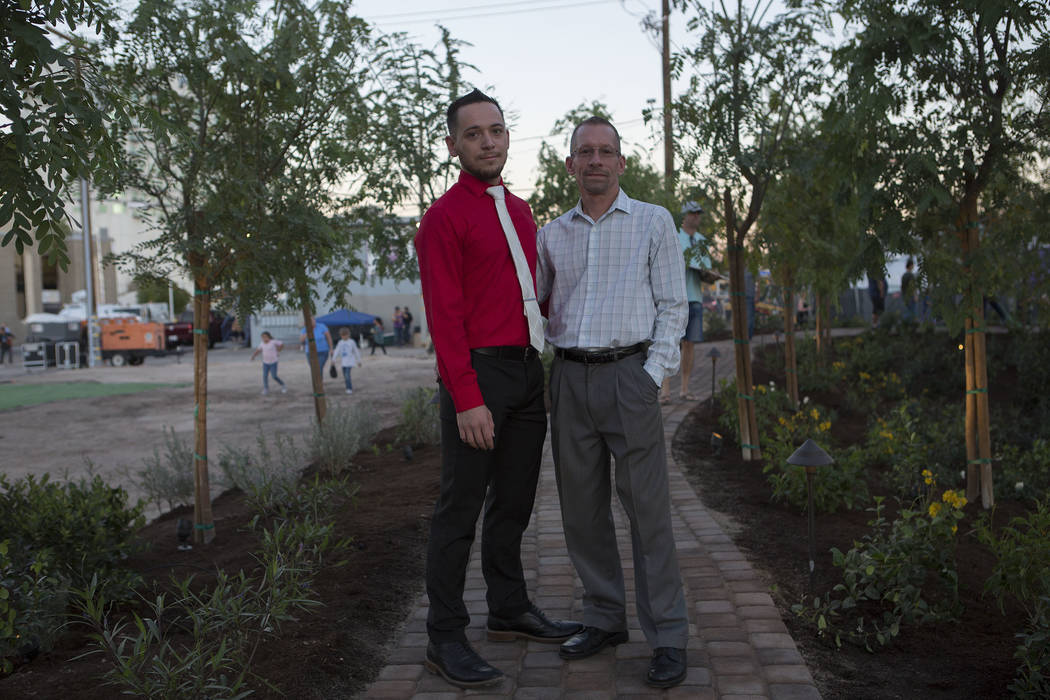Ian Perry, left, and Tracy Hook, friends of Las Vegas city employee Cameron Robinson, at the healing garden in Las Vegas, Friday, Oct. 6, 2017. This is the 15th anniversary of First Friday downtow ...