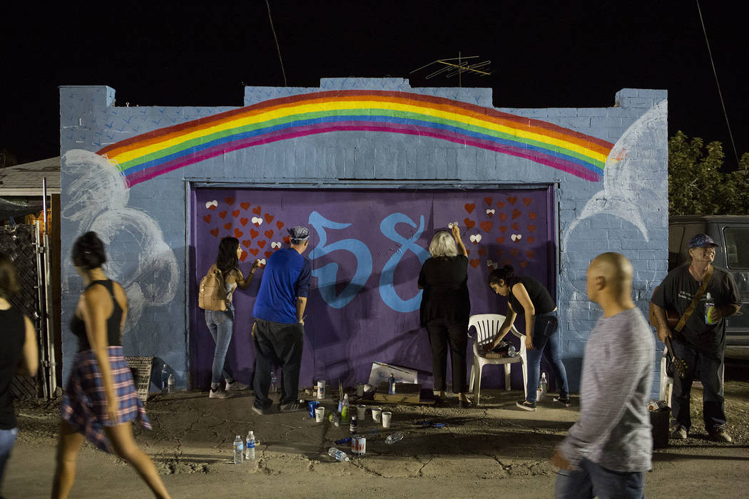 Artists work on a mural for the 58 victims of the Sunday shooting at First Friday in Las Vegas, Friday, Oct. 6, 2017. This is the 15th anniversary of First Friday downtown Las Vegas. Bridget Benne ...
