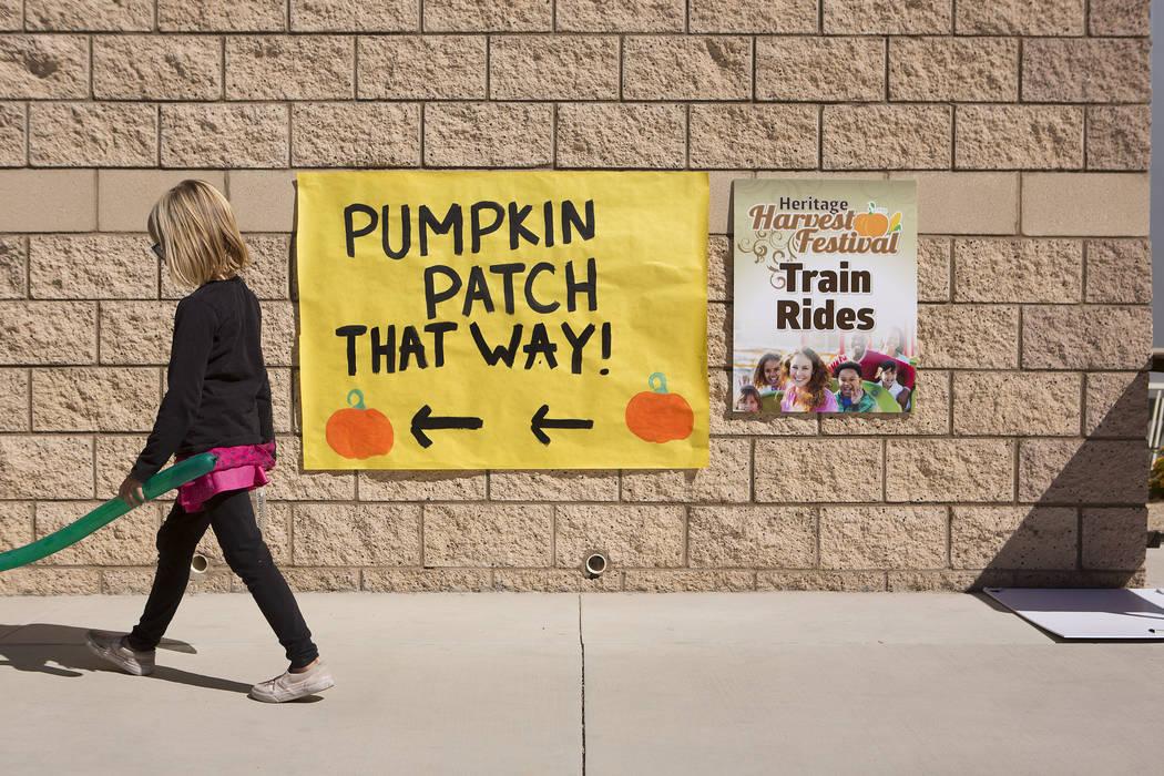 A child passes a sing for a Pumpkin Patch at Heritage Harvest Festival  in Henderson, Saturday, Oct. 7, 2017.  Bridget Bennett Las Vegas Review-Journal @Bridgetkbennett