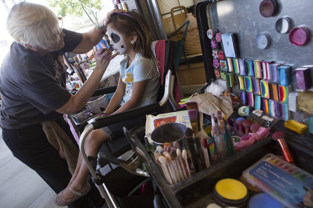 Julia Urquieta, 6, gets her face painted by Joy Bross at Heritage Harvest Festival  in Henderson, Saturday, Oct. 7, 2017.  Bridget Bennett Las Vegas Review-Journal @Bridgetkbennett