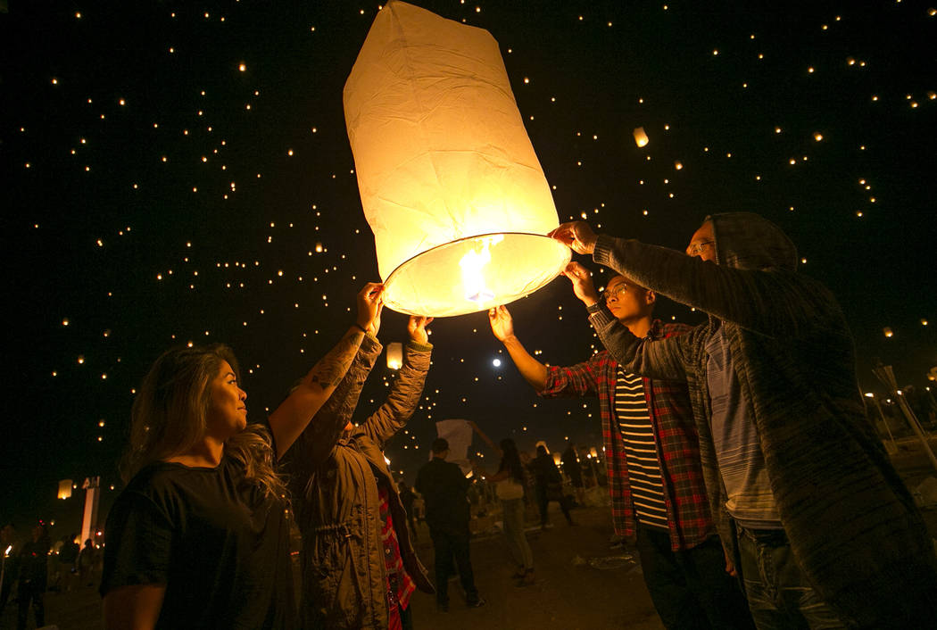 Participants prepare to release a lanterns during the Rise Festival held at the Moapa River Indian Reservation on Friday, Oct. 6, 2017. Richard Brian Las Vegas Review-Journal @vegasphotograph