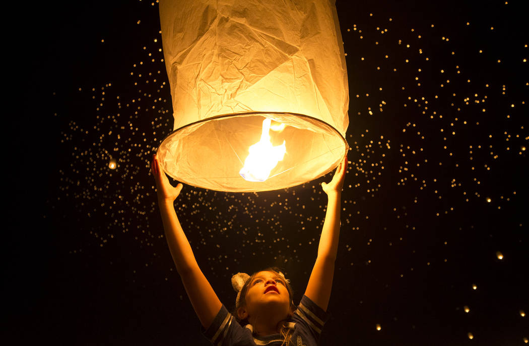Mkilawish Arres, 9, of California prepares to release a lantern during the Rise Festival held at the Moapa River Indian Reservation on Friday, Oct. 6, 2017. Richard Brian Las Vegas Review-Journal  ...