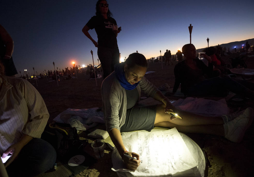 Erika Roman of California writes a message on a lantern during the Rise Festival held at the Moapa River Indian Reservation on Friday, Oct. 6, 2017. Richard Brian Las Vegas Review-Journal @vegasph ...