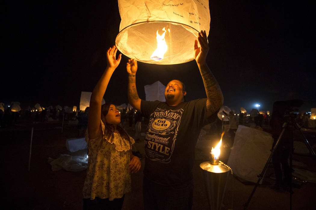 Harold Arres and his daughter Hattie release a lantern during the Rise Festival held at the Moapa River Indian Reservation on Friday, Oct. 6, 2017. Richard Brian Las Vegas Review-Journal @vegaspho ...