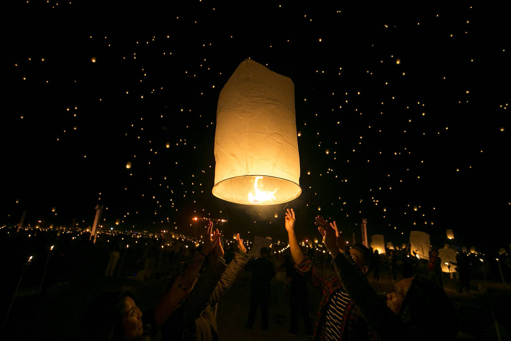 Participants release a lanterns during the Rise Festival held at the Moapa River Indian Reservation on Friday, Oct. 6, 2017. Richard Brian Las Vegas Review-Journal @vegasphotograph