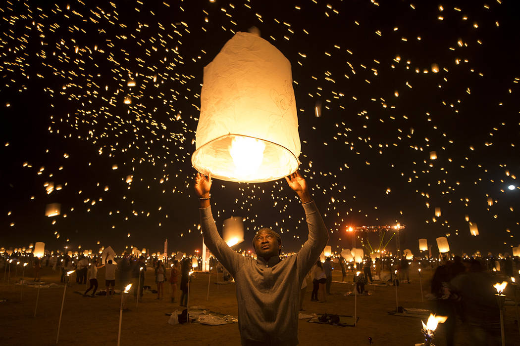 Learie Hercules of the Republic of Trinidad and Tobago releases a lantern during the Rise Festival held at the Moapa River Indian Reservation on Friday, Oct. 6, 2017. Richard Brian Las Vegas Revie ...