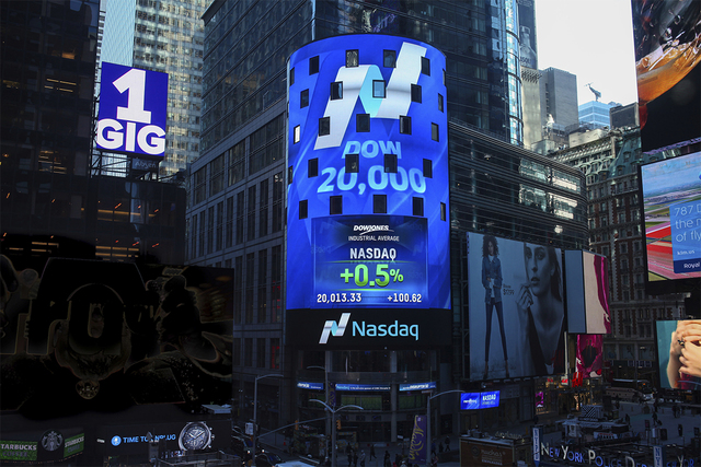 The Nasdaq Tower in New York's Times Square displays the Dow Jones industrial average after it crossed the 20,000 mark for the first time, Wednesday, Jan. 25, 2017. (Rohini Shahriar/Nasdaq via AP)