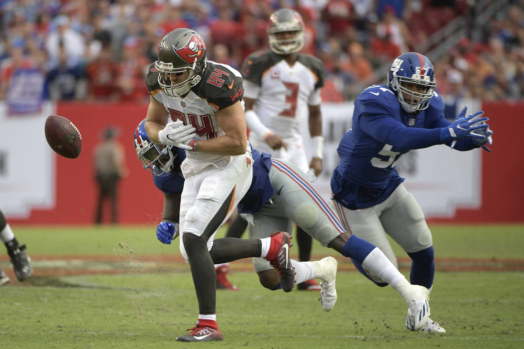 New York Giants strong safety Landon Collins (21) breaks up a pass intended for Tampa Bay Buccaneers tight end Cameron Brate (84) during the second half of an NFL football game Sunday, Oct. 1, 201 ...