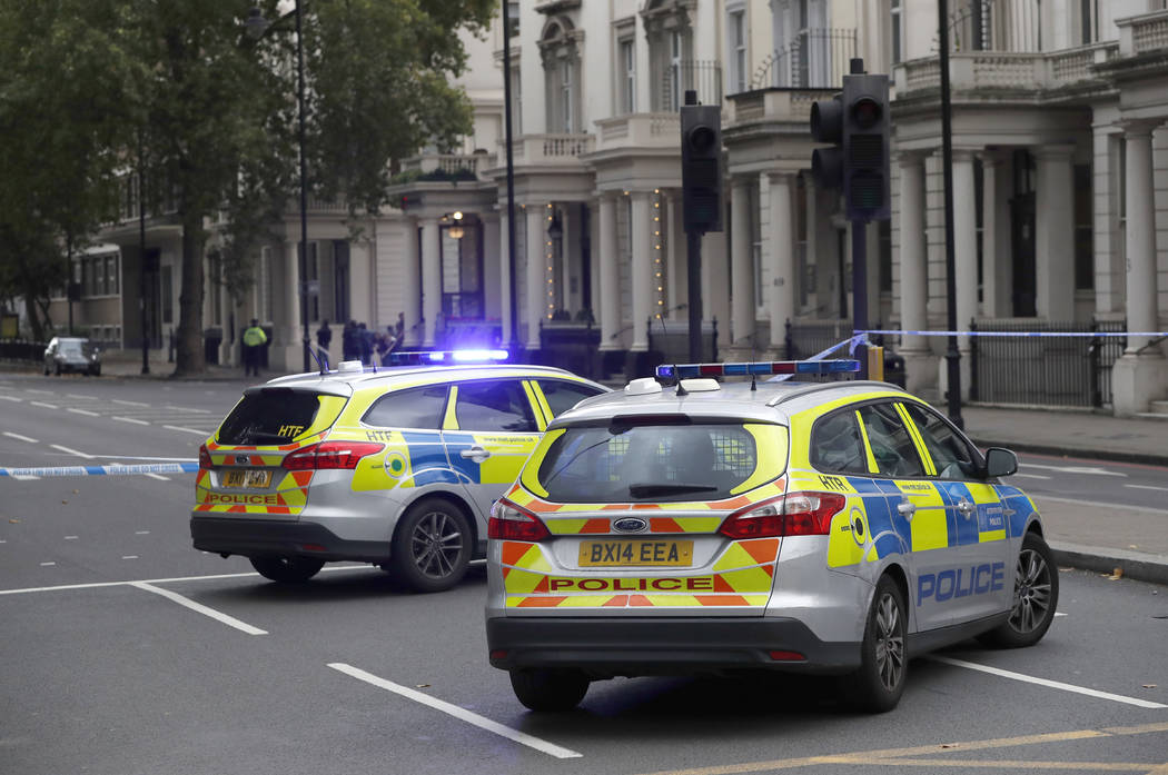 Britain's police cars at the scene of an incident in central London, Saturday, Oct. 7, 2017. London police say emergency services are outside the Natural History Museum in London after a car struc ...