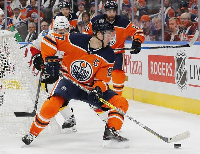 Oct 4, 2017; Edmonton, Alberta, CAN; Calgary Flames defensemen TJ Brodie (7) tires to check Edmonton Oilers forward Connor McDavid (97) during the first period at Rogers Place. Mandatory Credit: P ...