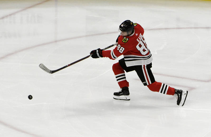 Oct 7, 2017; Chicago, IL, USA; Chicago Blackhawks right wing Patrick Kane (88) scores a goal against the Columbus Blue Jackets during the first period at United Center. Mandatory Credit: David Ban ...