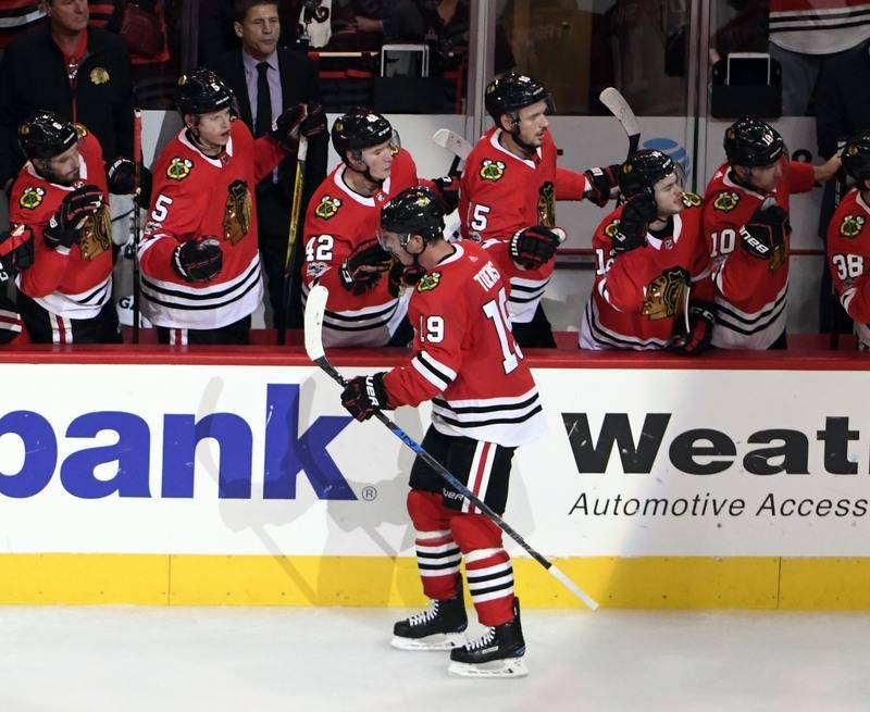 Oct 7, 2017; Chicago, IL, USA; Chicago Blackhawks center Jonathan Toews (19) celebrates his goal against the Columbus Blue Jackets with his teammates during the second period at United Center. Man ...