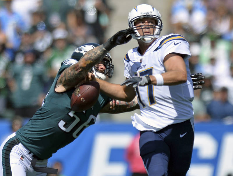 Oct 1, 2017; Carson, CA, USA; Los Angeles Chargers quarterback Philip Rivers (17) fumbles after being hit by Philadelphia Eagles defensive end Chris Long (56) during the first quarter at StubHub C ...
